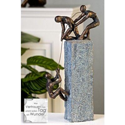 """Casablanca Skulptur """"Assistance"""" Poly bronzefarben graue Base in Steinoptik mit Spruchanhänger"""