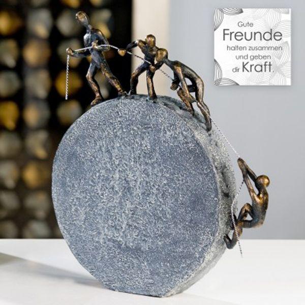 """Casablanca Skulptur """"Lifting"""" Poly bronzefarben graue Base in Steinoptik mit Spruchanhänger"""